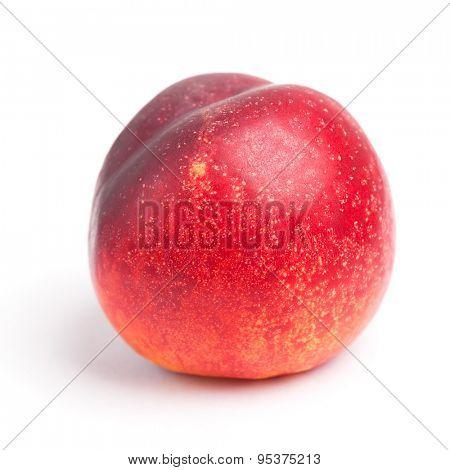 One nectarine isolated on white background
