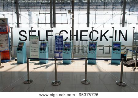BANGKOK, THAILAND - JUNE 19, 2015: self check-in kiosks in Suvarnabhumi Airport. Suvarnabhumi Airport is one of two international airports serving Bangkok