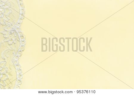 Yellow Delicate satin background with lace border. Horizontal image.