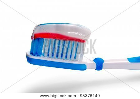Blue toothbrush with tricolor toothpaste. Isolate on a white background