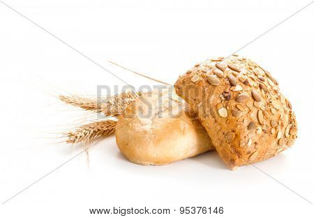 Bread loaf with pumpkin seeds and wheat. Isolate on a white background