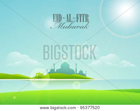 Beautiful mosque on shiny cloudy nature background, Creative greeting card design for Islamic festival, Eid-Al-Fitr celebration.