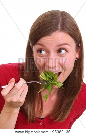 Pretty girl is eating salad