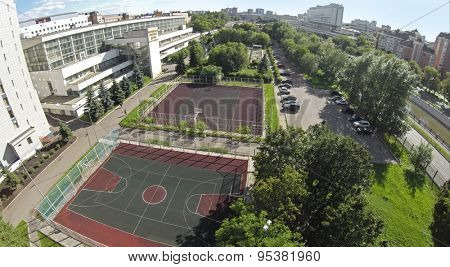 RUSSIA, MOSCOW - JUN 29, 2014: Townscape with playgrounds near edifice of sports complex of MGTU named by Bauman at summer day. Aerial view. Photo with noise from action camera
