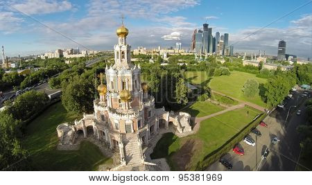 RUSSIA, MOSCOW - 19 JUN, 2014: Aerial view edifice of church Pokrova in Fili and cityscape with Moscow Business Center at summer day. Photo with noise from action camera