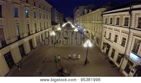 RUSSIA, MOSCOW - JUN 1, 2014: Aerial view people walk by Arbat street at summer evening. Photo with noise from action camera