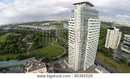 RUSSIA, MOSCOW - JUN 19, 2014: Aerial view edifice of Metalloinvest company against cityscape at summer day. Photo with noise from action camera