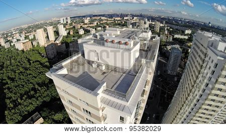 RUSSIA, MOSCOW - JUN 24, 2014: Aerial view of megapolis with tall residential complex at summer sunny day on Elk island. Photo with noise from action camera