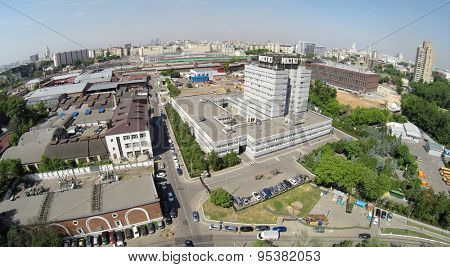 RUSSIA, MOSCOW - JUN 6, 2014: Cityscape with headquarters of Mosgaz company at summer sunny day. Aerial view. Photo with noise from action camera