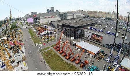 RUSSIA, MOSCOW - JUN 6, 2014: Building machines on 15th International Specialized Exhibition of Construction Equipment and Technologies CET 2014 at Crocus Expo. Photo with noise from action camera