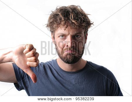 Disappointed man with thumbs down