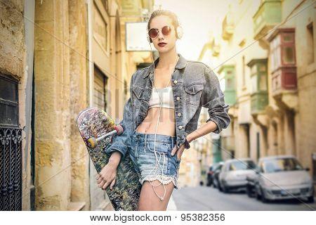 Urban girl standing in a street