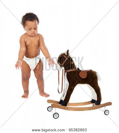 Funny african baby in diaper with a wooden horse isolated on a white background