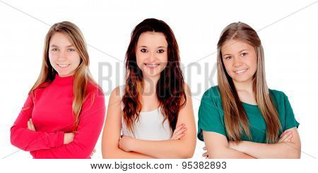 Three teenager girls with crossed arms isolated on a white background