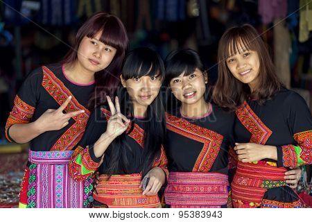 MAI CHAU, VIETNAM, DECEMBER 20, 2015 : Group of tourists Vietnamese girls wearing traditional Hmong ethnicity costume, posing in the village of Mai Chau, Vietnam.