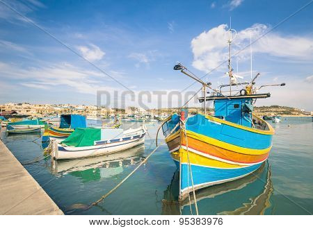 Colorful Typical Boats In Marsaxlokk - Mediterranean Traditional Fisherman Village In The South East