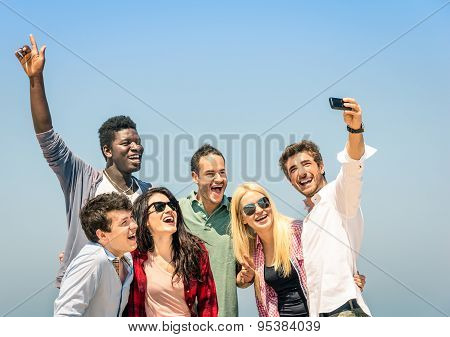 Group Of Multiracial Friends Taking A Selfie On The Blue Sky - Concept Of Happiness And Friendship