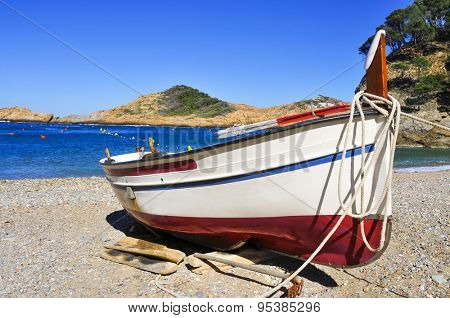 closeup of a fishing boat stranded on Sa Tuna beach in Begur, in the Costa Brava, Catalonia, Spain