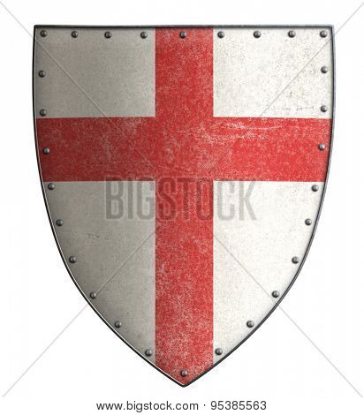 medieval crusader's metal shield with red cross isolated