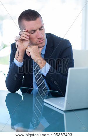 Thoughtful businessman in his office at work