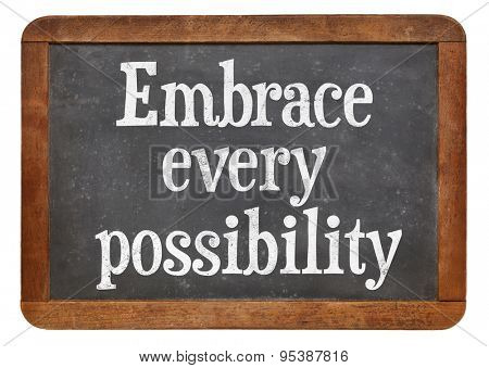 Embrace every possibility - motivational advice on a vintage slate blackboard