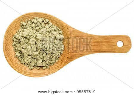kelp seaweed powder - top view of a wooden spoon isolated on white