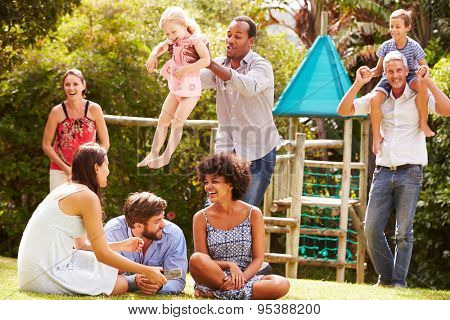 Adults and kids having fun in a garden