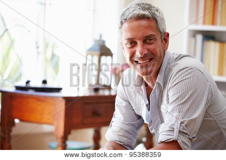 Portrait of�¿a smiling grey haired man