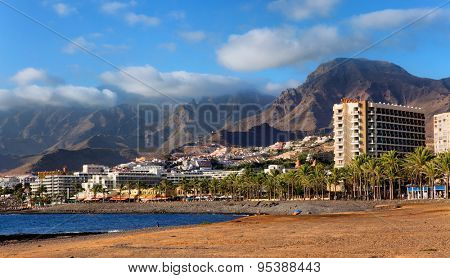 TENERIFE, SPAIN - JULY 17: View of the Playa de las Americas. Playa de las Americas is a purpose-built holiday resort in the southern and southern-west part of the Municipality of Arona