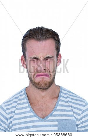 Casual man crying in front of camera on white background