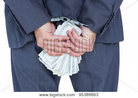 businessman in handcuffs holding bribe on white background