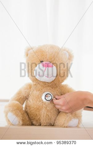 Teddy bear with doctor and stethoscope in the medical office