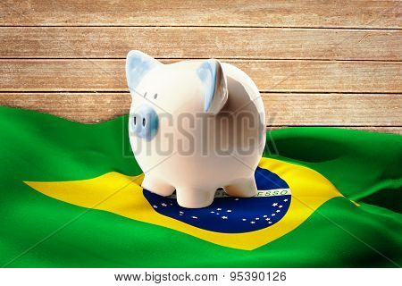 Piggy bank against wooden planks background