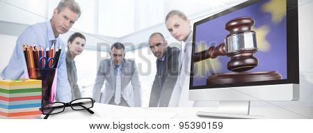 Computer screen against hand banging gavel on sounding block