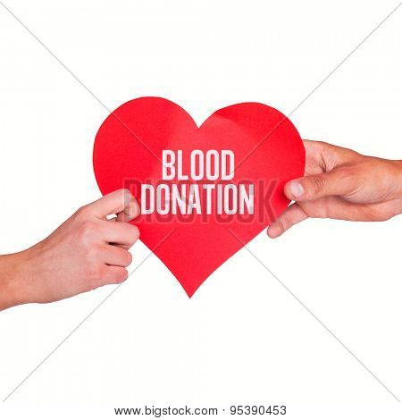 Hands holding red heart against blood donation