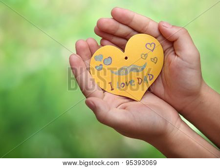 Child's hands with a Father's Day card
