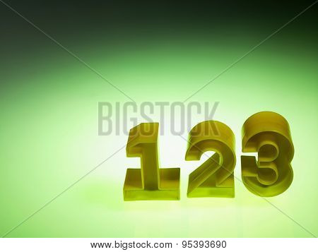 plastic numbers 1 2 3 on green background