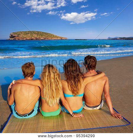 friends group couples sitting in beach sand rear view Ibiza photo mount