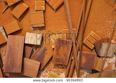 Carpenter sawdust and decking pieces after ipe wood deck work