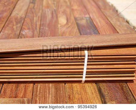 Ipe decking installation with wood slats and flooring background