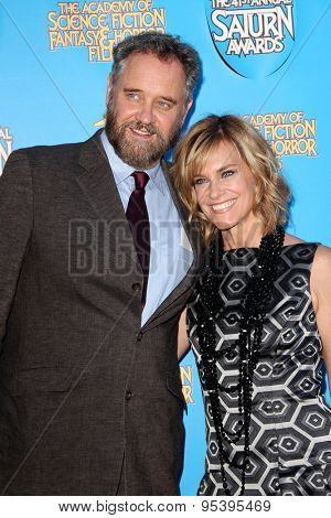 BURBANK - JUNE 25: Lance Guest and Catherine Mary Stewart arrive at the 41st Annual Saturn Awards on Thursday, June 25, 2015 at the Castaway Restaurant in Burbank, CA.