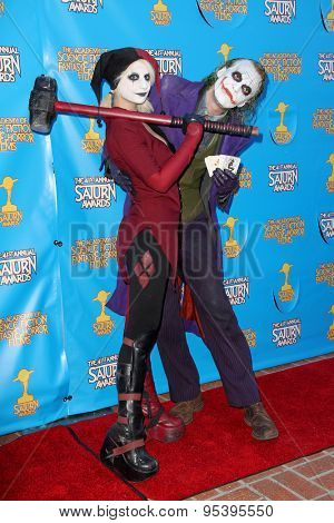 BURBANK - JUNE 25: Cosplayers Harley Quinn and The Joker arrive at the 41st Annual Saturn Awards on Thursday, June 25, 2015 at the Castaway Restaurant in Burbank, CA.