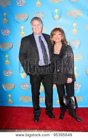 BURBANK - JUNE 25: Dawn Wells and guest arrive at the 41st Annual Saturn Awards on Thursday, June 25, 2015 at the Castaway Restaurant in Burbank, CA.