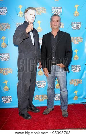 BURBANK - JUNE 25: Malek Akkad, with a cosplayer as Jason, arrives at the 41st Annual Saturn Awards on Thursday, June 25, 2015 at the Castaway Restaurant in Burbank, CA.
