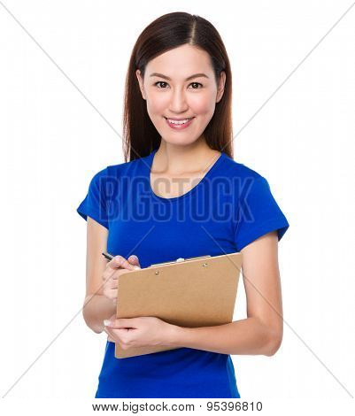 Asian woman jot note on clipoard