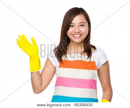 Housewife wear a pair of rubber gloves