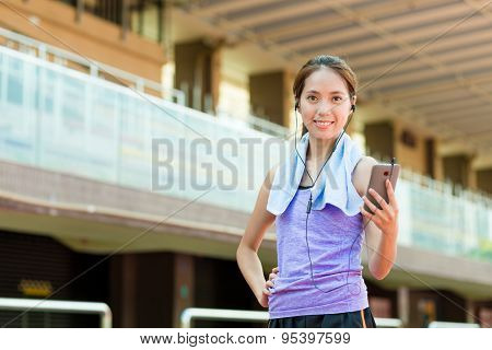 Woman listen to music after doing sport