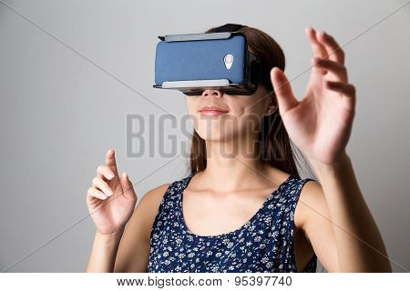 Young woman with virtual reality equipment