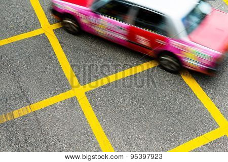 Blurred picture of Taxi speeding up in Hong Kong