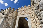 foto of aqueduct  - Detail of the gate seen from the side of the roman aqueduct in Segovia Spain - JPG